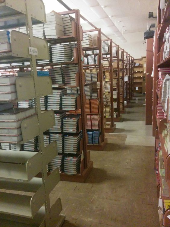 Redesigned textbook room should have high density shelving installed.