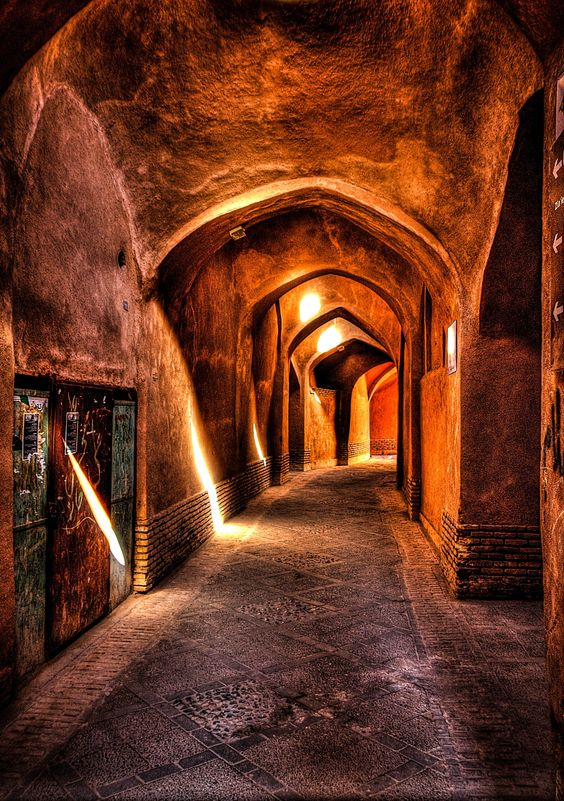 This is the old City of Yazd. Old brick and mud houses and arches taking their natural light from the opening in the Arches. A desert city on the silk Route.: