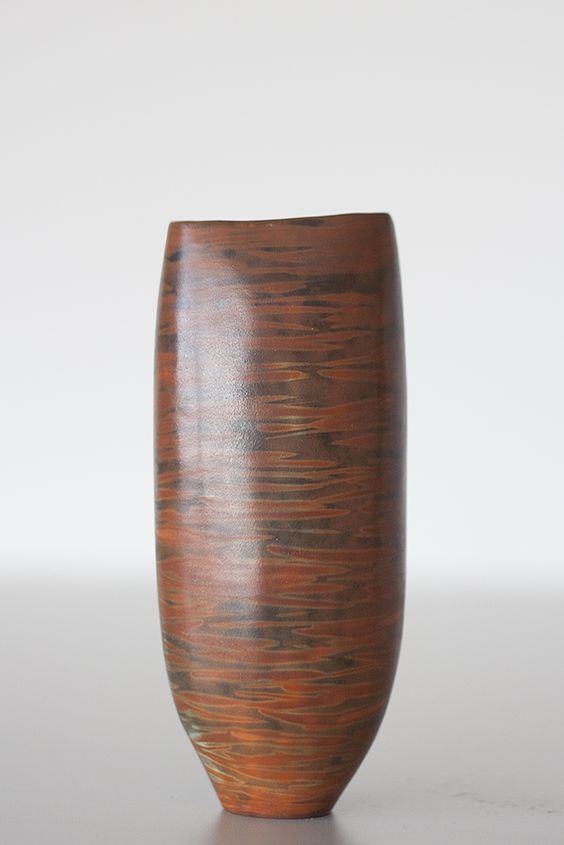 Liza Riddle's vessels are hand-coiled, carefully burnished to a smooth finish, then fired at earthenware temperatures.