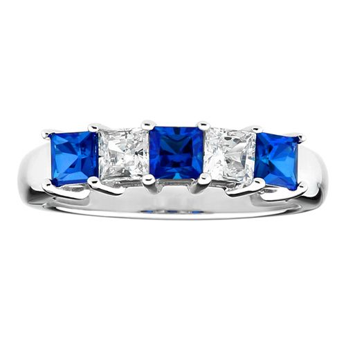 This elegant eternity anniversary ring is sterling silver with platinum plating. The ring is set with two clear and three royal blue, princess cut cubic zirconia stones.