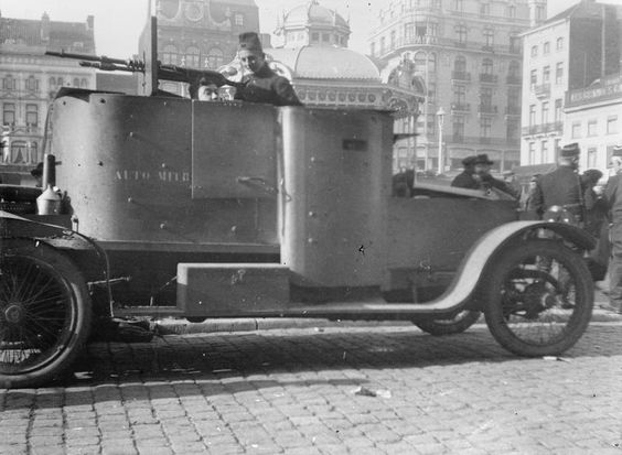 MINISTRY INFORMATION FIRST WORLD WAR OFFICIAL COLLECTION (Q 14789)   Belgian armoured motor car in the Square at Ostend, 10th October 1914.