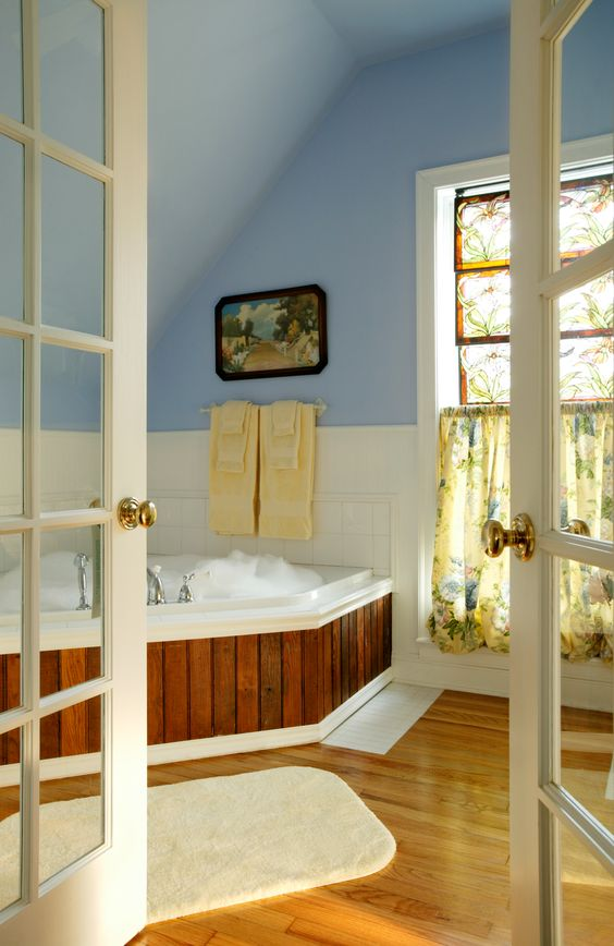 French doors lead to a Spa Bath in the Victoria's Garden Suite