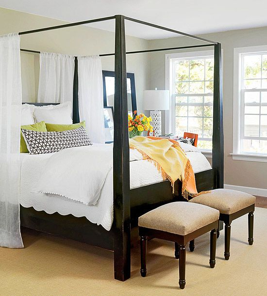 This four-poster directs eyes up, increasing the perceived ceiling height.