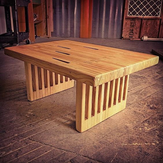 Kingpin Dining Table made from vintage reclaimed bowling lanes in New York City. Photo by CounterEv
