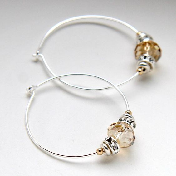https://www.notonthehighstreet.com/myhartbeading/product/silver-beads-and-swarovski-crystal-hoops
