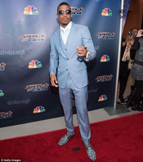 Still got his duties: The America's Got Talent host pictured at the season 10 red carpet event in New Jersey on Monday