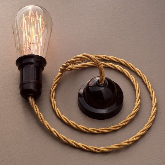 Mahogany ceiling rose, twisted gold textile cable and Squirrel cage bulb by Cablelovers