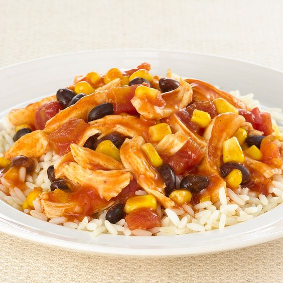 Serve shredded chicken slow cooked with tomatoes, corn and black beans ...