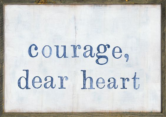 """This simple art print features a light background with the phrase, """"courage, dearheart"""" printed in the middle. Available in the following frame style: Grey Woo"""