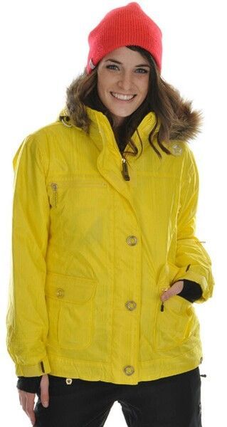 Madisyn is shown in a bright yellow ski jacket.