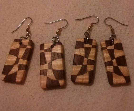 I love wood, it's such a warm and inviting medium. I like the way these earrings take something boring and structured and make it interesting and organic.If you can't make your own, you can buy them at my store here
