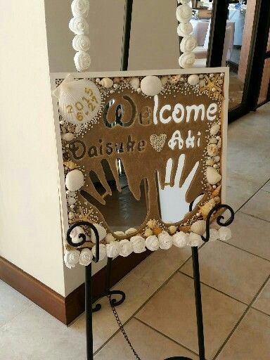 Welcome sign for a beach themed wedding.  Made with sand and sea shells on IKEA mirror.
