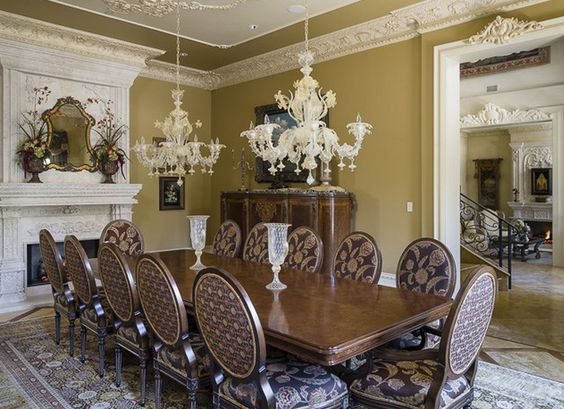 Formal dining room with two chandeliers and fireplace for Traditional dining room fireplace