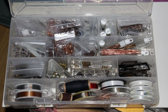 Wire, jeweler's thread, and findings - oh my.  Lots of chain, earring wires, headpins and more all stored in a convenient container which goes with me wherever I create jewelry.