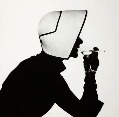 Irving Penn black and white high contrast photograph of his wife Lisa wearing a Christian Dior Hat in 1952