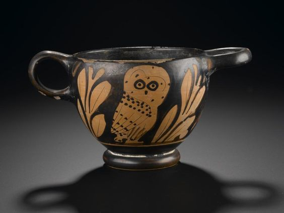 Glaux or skyphos (cup) of pottery decorated in red figure style with an owl between olive branches, with one vertical and one horizontal handle: Ancient Mediterranean, Ancient Greek, Attic, 5th century BC, c. 450 - 425 BC © National Museums Scotland: