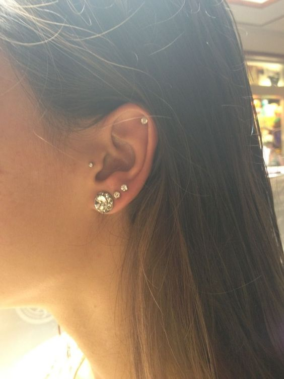 love the contrast of earring placement and size