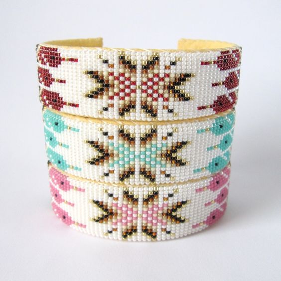 These are so lovely! New beaded cuffs by the Nathaniel family featuring a bold center starburst design edged with feathers in red earth, turquoise gulf, and blush pink. >> shop.beyondbuckskin.com #native #beadwork #navajo #southwest #beauty