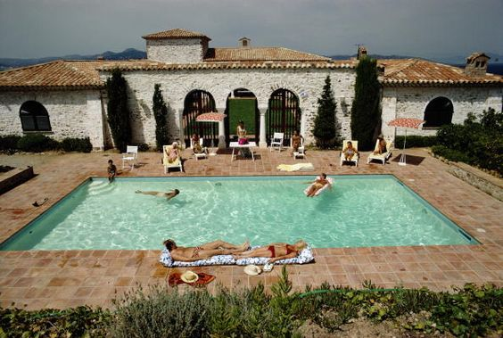 Pool In St Tropez. Slim Aarons.   Guests around the pool at a villa in St Tropez, France, circa 1970.: