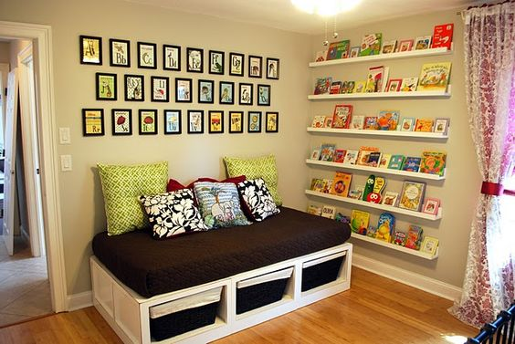 Nursery room art = shelves of colorful books!  LOVE it!