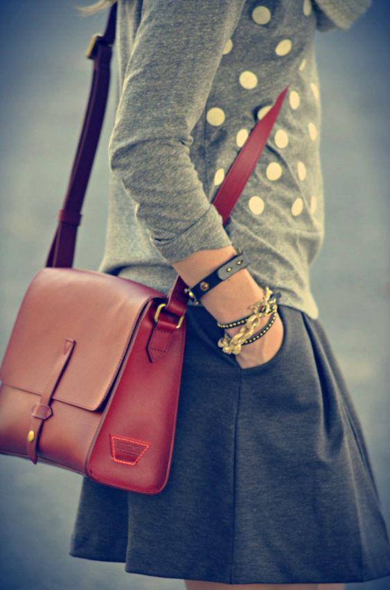 Grey dotted sweater, gold bracelets, black full mini, cross body purse