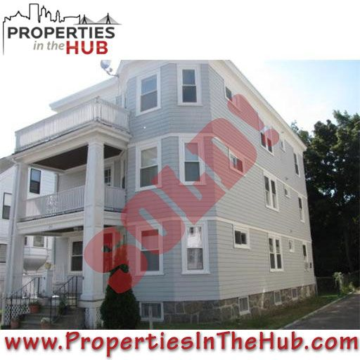 The first floor of this home was a great two bedroom condo close to everything, and at a great price, in Roslindale.