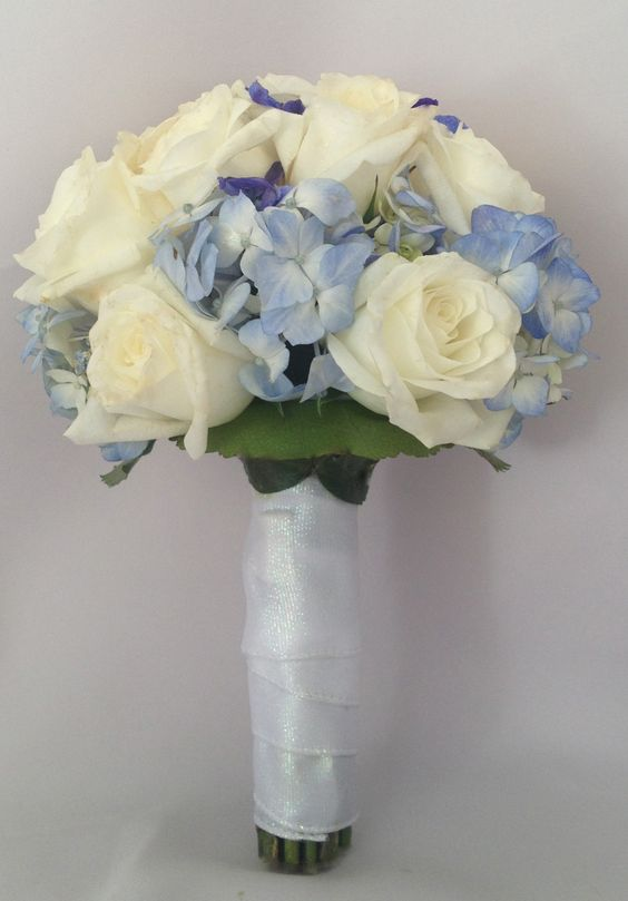 White and blue bridal wedding bouquet. Wedding. Roses ...