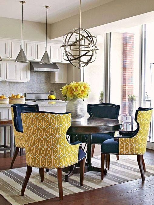 Mustard yellow and navy blue chairs. Image via High Fashion Home