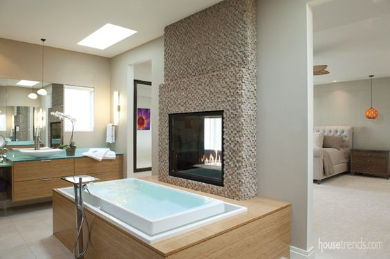 Contemporary bathroom with suspended sinks and infinity bathtub