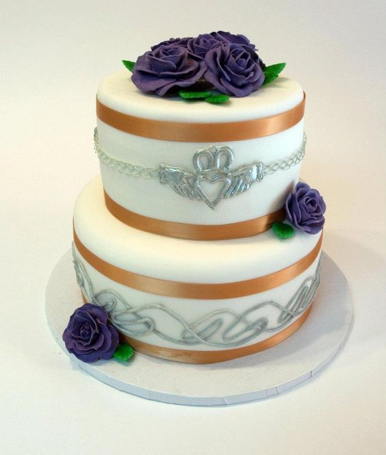 Perfect wedding cake, not antique-y like I want, but anything Irish and purple is worth it :)