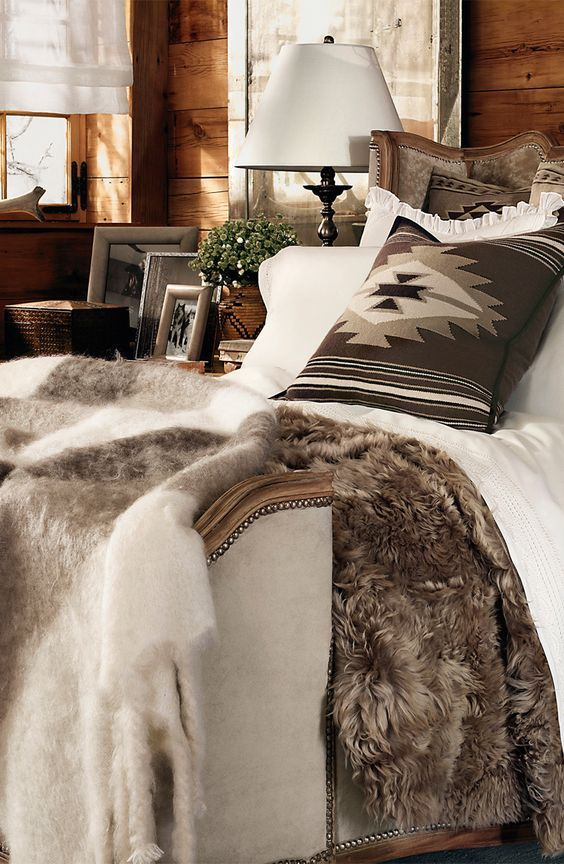 A cozy and glamorous Ralph Lauren Home bedding collection, Alpine Lodge features shades of cream and cocoa, bold patterns and luxe cashmere and shearling.: