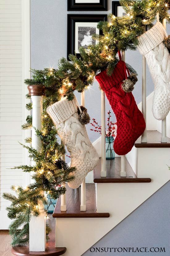 Christmas Entry Decor Garland Stockings Berries On Sutton Place Christmas Staircase Decor Christmas Stairs Decorations Christmas Staircase