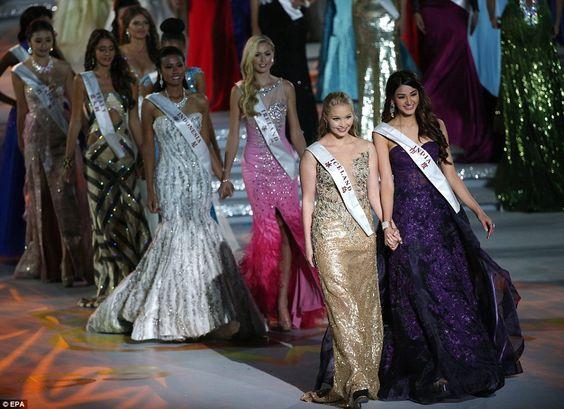 Competition: Miss Iceland Arna Yr Jonsdottir (front left) and Miss India Aditi Arya walk w...