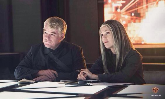 President Coin and Plutarch Heavensbee.  Mockingjay Part 1