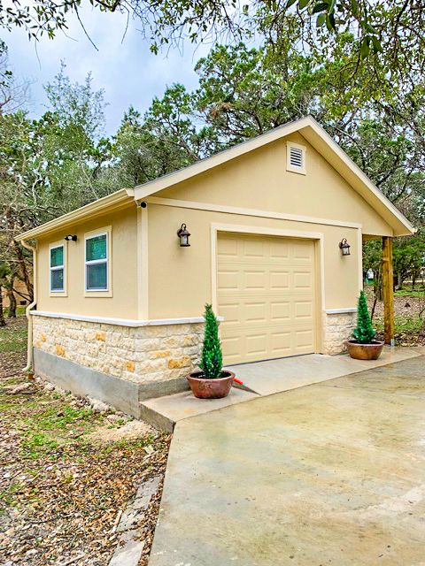 Design A Garage That Looks Great On Your Property This Single Car Garage Features Plenty Of Loft Space For Storage And Porch For Loft Spaces Ranch House Shed