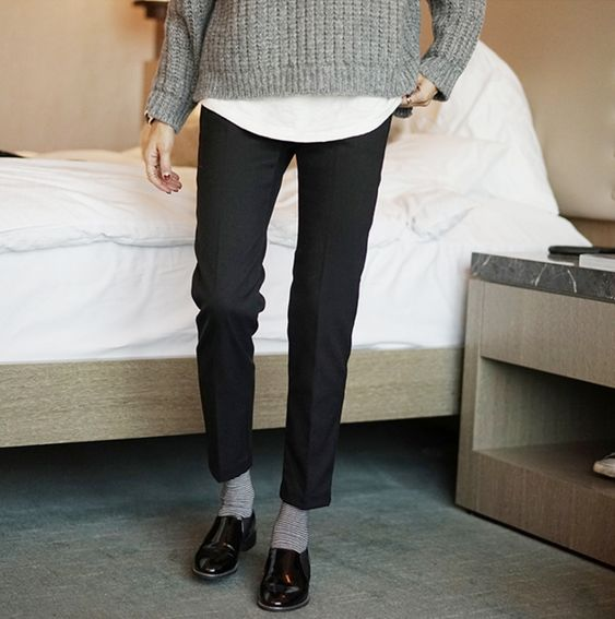 white tee, grey sweater, black pants, grey socks, black oxfords