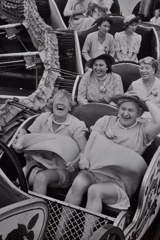 Women having fun back in the 40's on an amusement park ride.. gotta love it!!!