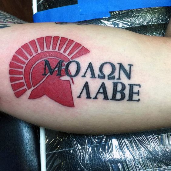 greek helmet in red ink with molon labe words tattoo on bicep of man tattoos pinterest. Black Bedroom Furniture Sets. Home Design Ideas