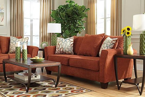 Upholstery colors and track on pinterest for Living room with rust colored sofa