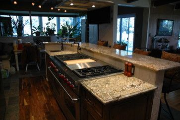 Colorado Style Kitchen view of the opposite end of the island featuring a professional range and granite countertops.