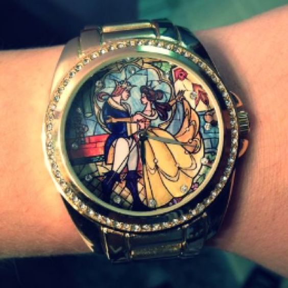 I have this! The colors are gorgeous and it fits like a boyfriend watch. It can be found at Hot Topic.