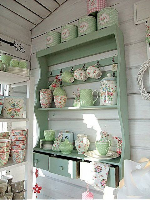 Beautiful mint green shelving with drawers.