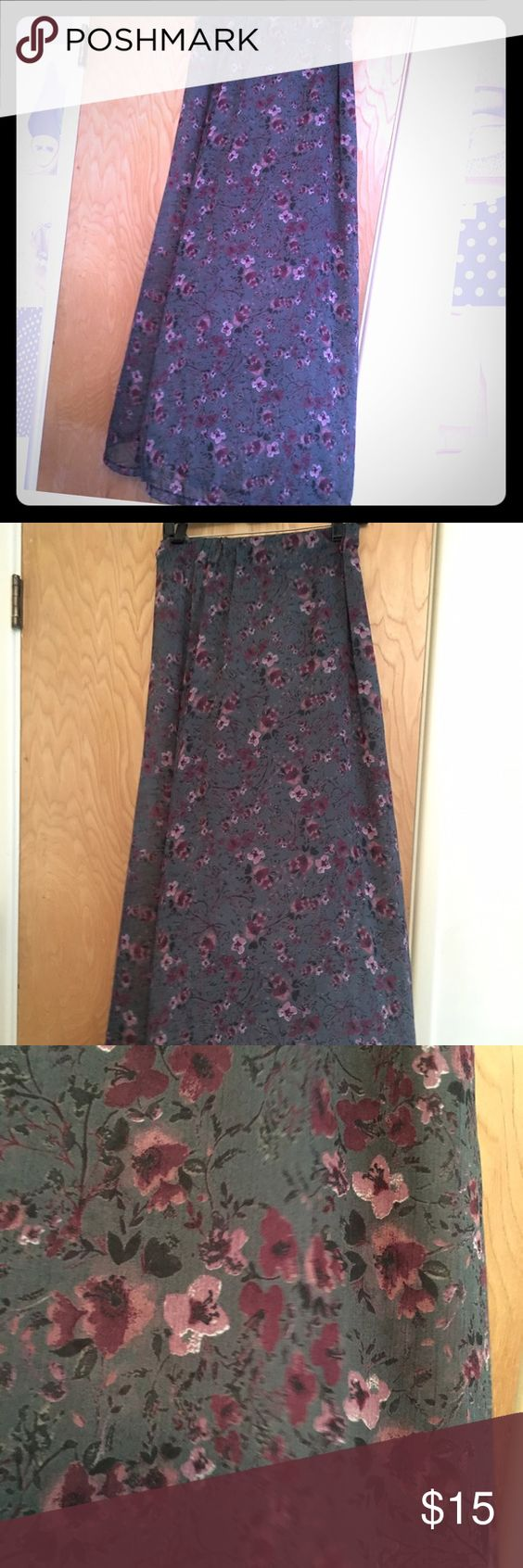 Brandy Melville floral skirt Like new Brandy Melville maxi skirt. Greenish blue background with purple flowers. Brandy Melville Skirts Maxi