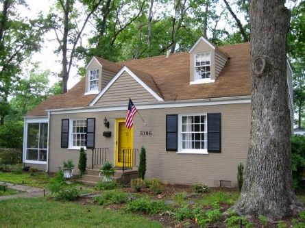 Nice tan house with shutters pop of color on the front for Tan siding shutter color combinations