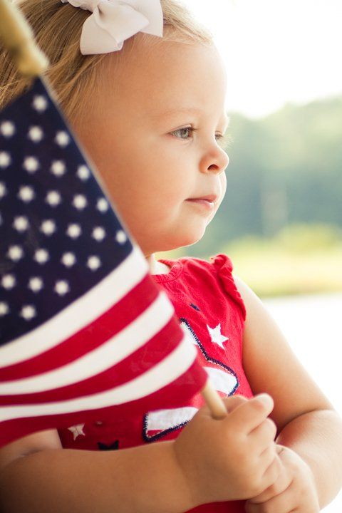 Cute little girl with a flag: