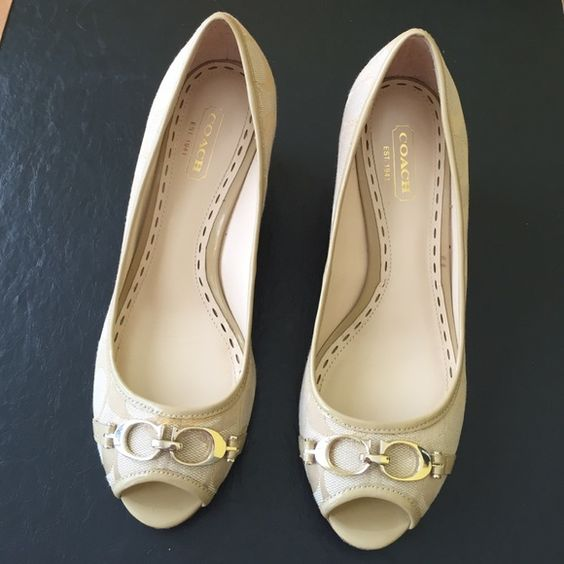 Women's..Coach Shoe... Size 6.5 B ...COACH shoe...EUC...Slip in.. Open toe ... Woodgrain 2 inch wedge heel... Neutral/beige color with gold CC buckle @ the toe Coach Shoes Wedges