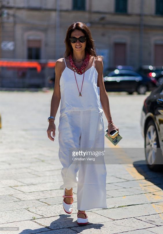 Viviana Volpicella wearing a white overall outside Gucci during the Milan Men's Fashion Week Spring/Summer 2017 on June 20, 2016 in Milan, Italy.