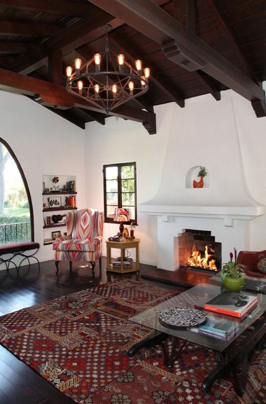 Brown window pane spanish influenced living room for Spanish revival interior design