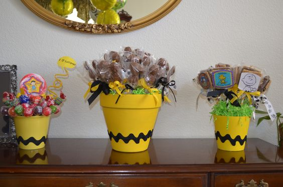Lollipops for all the guest.  Middle flower pot filled with handmade chocolate…: