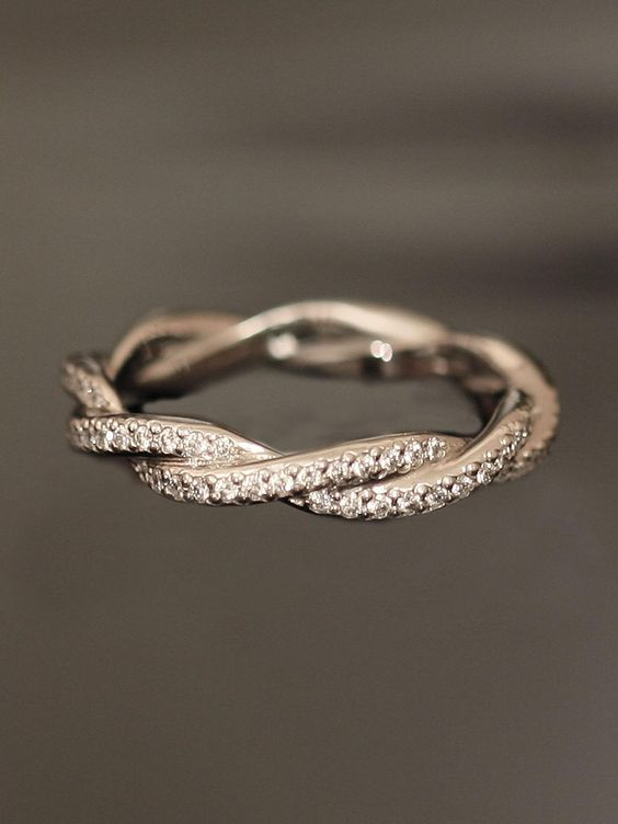 Platinum Double Twist Eternity Band. So unique and prettier than a traditional wedding band to go with your ring.